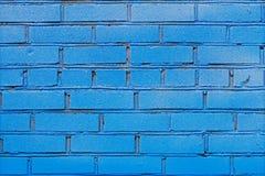 blå tegelstenvägg Arkivfoto