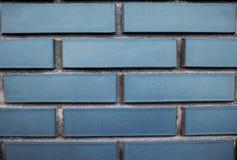 Blå tegelstenvägg för bakgrund arkivbilder