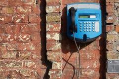 blå telefon arkivbild