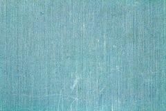 Blå textiltextur med fläckar och att blekna abstrakt bakgrund Royaltyfri Foto