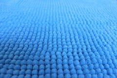 Blå textur av en mjuk matta Arkivbilder