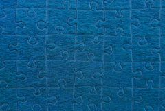 Blå textur av ett stycke av papperspusslet royaltyfri fotografi