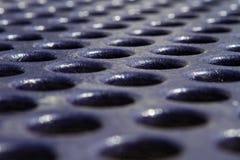 Blå textur för picknicktabell med hål fotografering för bildbyråer