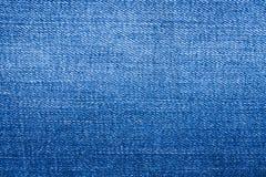 Blå textur för tygjeansbakgrund arkivfoton