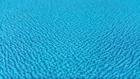 Blå textur/nära övre blå tygyttersida Arkivbilder