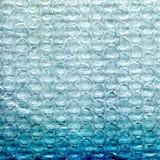 Blå texturerad bakgrund för skum plast- Arkivfoton