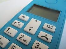 Blå trådlös telefon Royaltyfria Bilder