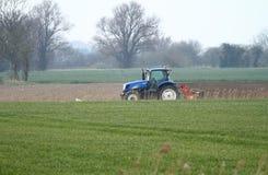 Blå traktor för singel Royaltyfri Foto
