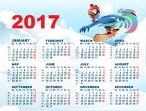 Blå tupp på snowboard Calendar med hanesymbolet 2017 Royaltyfria Bilder
