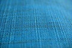 blå tyglampatextur Blå torkdukebakgrund Övre sikt för slut av blå tygtextur och bakgrund Arkivbild