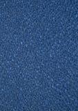 blå tygtextur Texturen av tyget som göras virkning Arkivbilder