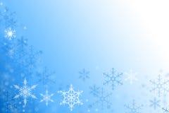 Blå vinterbakgrund med snöflingatextur Arkivbilder