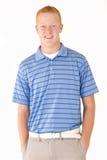 Blåa ögon för ung rödhårig man i poloskjorta Royaltyfri Foto