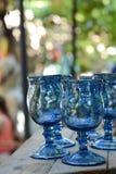 Blåa dricka exponeringsglas Royaltyfri Bild