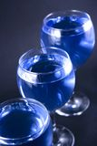blåa drinkexponeringsglas Royaltyfria Foton