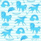 Blåa enhörningar med stjärnor på en vit och akvamarinbakgrundsvågor Royaltyfri Bild