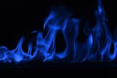 Blåa flammor av brand som abstrakt backgorund Royaltyfria Foton