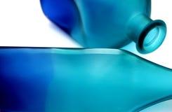 blåa flaskor Arkivfoton