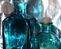 blåa flaskor royaltyfria foton