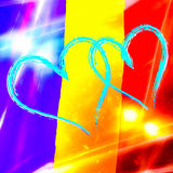 Blåa hjärtor på romanian flaggabakgrund Arkivbild