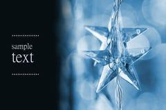 blåa julstjärnor Arkivbild