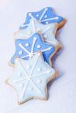 blåa julstjärnor för kexar Fotografering för Bildbyråer