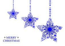 Blåa julstjärnor med snöflingor på en vit bakgrund Holi Arkivfoton