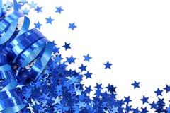 blåa konfettistjärnor arkivbild
