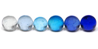 blåa marmorar Arkivfoto