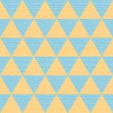 Blåa och orange trianglar för sömlöst abstrakt begrepp Kulört träbräde Arkivbilder