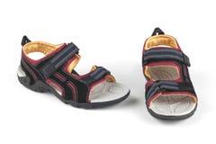 Blåa och röda sandaler arkivbild