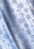 Blåa snöflingor på grånar blå krabb lutningbakgrund Royaltyfri Foto