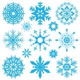 blåa snowflakes vektor illustrationer