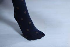 Blåa strumpor med prickar royaltyfria foton
