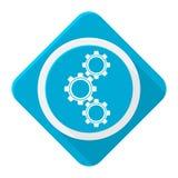 Blåa symbolskugghjul med lång skugga Arkivfoton