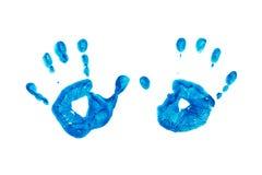 Blåa tryck av barns händer som isoleras på vit bakgrund Arkivfoto