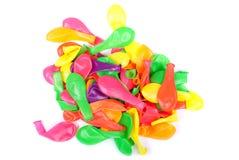 Blåsa bort mycket färgrika ballonger på den isolerade bakgrunden Royaltyfri Fotografi
