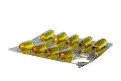 Blåsapacke av isolerade gula preventivpillerar Arkivbild