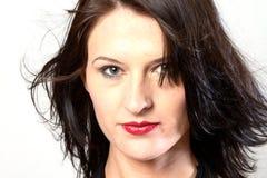blåsig kvinna för mörkt hår Arkivbild