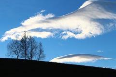 Blåsiga moln Arkivfoto
