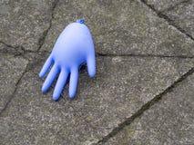 Blåst upp blå rubber handske Arkivbild
