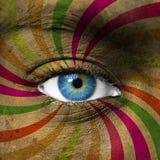 Blått öga och abstrakta färgrika band Fotografering för Bildbyråer