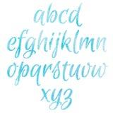 Blått alfabet för vattenfärg Arkivbild