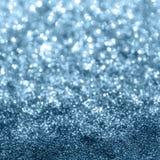 Blått blänker bokehbakgrund Fotografering för Bildbyråer