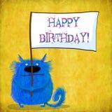 Blått Cat With Placard för födelsedagkort Arkivbilder