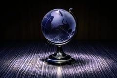 Blått crystal jordklot Arkivfoto