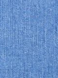 blått denimmaterial för bakgrund royaltyfri foto