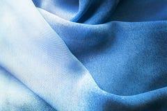 Blått draperat silke arkivfoto