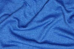 Blått draperat tyg arkivfoto