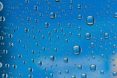 blått droppvatten Arkivfoton